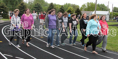 South Central Calhoun High School students chat while walking around the track May 11. Students participated in a 30-minute walk as part of a Live Healthy Iowa program. GRAPHIC-ADVOCATE PHOTO/ERIN SOMMERS