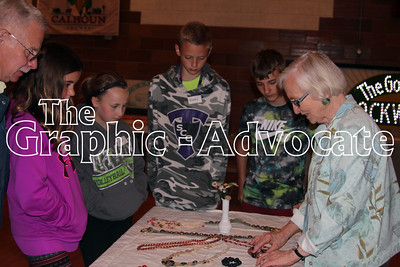 Marlene Johnson, right, a Calhoun County Museum board member, talks about buttons to South Central Calhoun Middle School students Friday during Pioneer Day. GRAPHIC-ADVOCATE PHOTO/ERIN SOMMERS