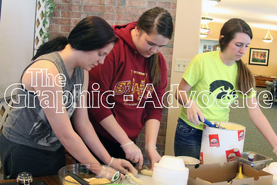 Mady Dick, Sarah Legore and McKailey Wheeler dish up banana splits April 22 at Shady Oaks in Lake City. The students, all part of the South Central Calhoun High School Life Skills class, have been helping at the care center about once a month. GRAPHIC-ADVOCATE PHOTO/ERIN SOMMERS
