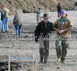 An Iowa State Patrol trooper escorts a Dakota Access protester away from a construction site Saturday afternoon. GRAPHIC-ADVOCATE PHOTO/ERIN SOMMERS