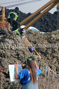 Two Dakota Access security guards try to remove a pipeline protester from the construction site Saturday afternoon. GRAPHIC-ADVOCATE PHOTO/ERIN SOMMERSA