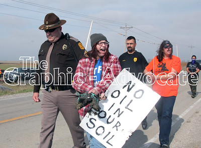 Protesters shout chants after being arrested at a Dakota Access pipeline construction site Saturday afternoon. GRAPHIC-ADVOCATE PHOTO/ERIN SOMMERS