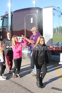 Peterson Transportation Inc. truck driver Mike Juhl gives a high five to a South Central Calhoun Middle School student Sept. 28. Juhl is partnering with Sara Stevens' fifth-grade class to teach students about math and geography while he drives is truck around the Midwest. GRAPHIC-ADVOCATE PHOTO/ERIN SOMMERS