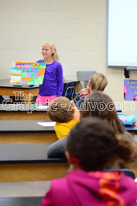Tori Ellis, a fifth-grade student at South Central Calhoun Middle School, shows her poster presentation to classmates Thursday afternoon. Students had the choice to make a poster or Google slide presentation to talk about what they learned about states of matter. GRAPHIC-ADVOCATE PHOTO/ERIN SOMMERS