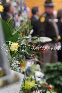 Flowers and other memorial items are seen at Urbandale Police Officer Justin Martin's funeral Tuesday. GRAPHIC-ADVOCATE PHOTO/ERIN SOMMERS