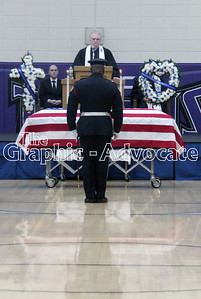 An officer pays his respects at Urbandale Police Officer Justin Martin's casket. GRAPHIC-ADVOCATE PHOTO/ERIN SOMMERS