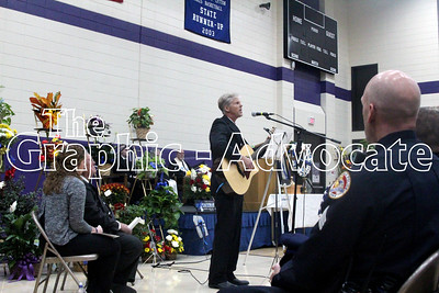 Brian Lantz sings a song about Urbandale Officer Justin Martin during Martin's funeral Tuesday at South Central Calhoun Middle School. GRAPHIC-ADVOCATE PHOTO/ERIN SOMMERS