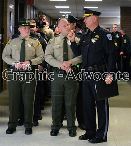 Law enforcement officers wait to enter the South Central Calhoun Middle School gym Tuesday morning for Urbandale Police Officer Justin Martin's funeral. GRAPHIC-ADVOCATE PHOTO/ERIN SOMMERS
