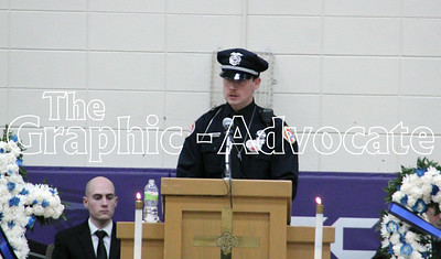 Urbandale Police Officer Brady Farrington talks about Officer Justin Martin during Martin's funeral Tuesday in Rockwell City. Farrington and Martin grew up together and joined the Urbandale Department at the same time. GRAPHIC-ADVOCAT PHOTO/ERIN SOMMERS
