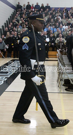 An officer enters the South Central Calhoun gym for Officer Justin Martin's funeral Tuesday morning. GRAPHIC-ADVOCATE PHOTO/ERIN SOMMERS