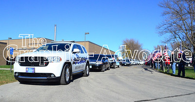 A Rockwell City police car waits outside South Central Calhoun Middle School Tuesday afternoon, following Urbandale Police Officer Justin Martin's funeral. GRAPHIC-ADVOCATE PHOTO/ERIN SOMMERS