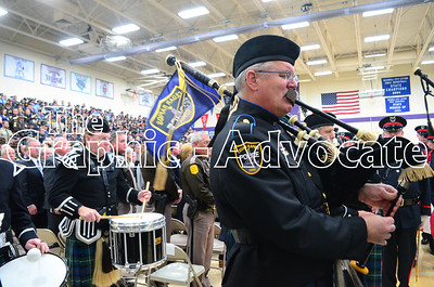 A police officer plays the bagpipes following the funeral service for Urbandale Police Officer Justin Martin Tuesday in Rockwell City. GRAPHIC-ADVOCATE PHOTO/ERIN SOMMERS