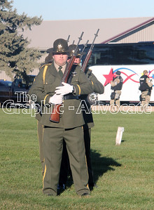 Officers prepare to fire the 21-gun salute at Rosehill Cemetery Tuesday afternoon. GRAPHIC-ADVOCATE PHOTO/ERIN SOMMERS