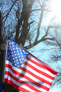 A flag is seen oustide South Central Calhoun Middle School Tuesday afternoon, following Urbandale Officer Justin Martin's funeral. GRAPHIC-ADVOCATE PHOTO/ERIN SOMMERS