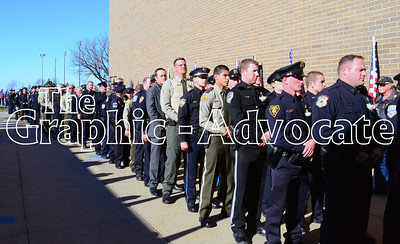 Law enforcement officers line the west side of South Central Calhoun Middle School Tuesday morning, prior to Urbandale Police Officer Justin Martin's funeral. GRAPHIC-ADVOCATE PHOTO/ERIN SOMMERS