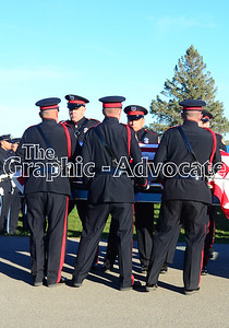 An honor guard removes Urbandale Police Officer Justin Martin's casket from a hearse at Rosehill Cemetery Tuesday afternoon. GRAPHIC-ADVOCATE PHOTO/ERIN SOMMERS