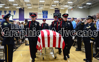 An honor guard escorts Urbandale Police Officer Justin Martin's casket out of the South Central Calhoun Middle School gym Tuesday, following Martin's funeral. GRAPHIC-ADVOCATE PHOTO/ERIN SOMMERS