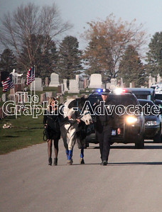A riderless horse enters Rosehill Cemetery during the procession for Urbandale Police Officer Justin Martin. GRAPHIC-ADVOCATE PHOTO/ERIN SOMMERS