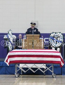 Urbandale Police Chief Ross McCarty talks about Officer Justin Martin during Martin's funeral Tuesday in Rockwell City. GRAPHIC-ADVOCATE PHOTO/ERIN SOMMERS