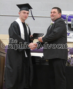 South Central Calhoun School Board President Ron Maulsby, right, shakes hands with Alexander Campbell, after handing Campbell his diploma Sunday. GRAPHIC-ADVOCATE PHOTO/ERIN SOMMERS