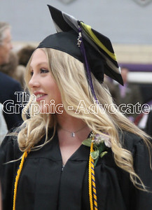 Brooklin McKinney smiles as she takes her seat during the South Central Calhoun High School commencement ceremony Sunday afternoon. GRAPHIC-ADVOCATE PHOTO/ERIN SOMMERS