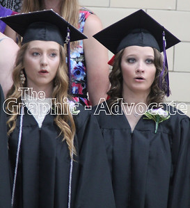 "Lindsey Sweeney, left, and MaKayla Patterson sing ""Home"" during the South Central Calhoun High School Class of 2017 Commencement Sunday. GRAPHIC-ADVOCATE PHOTO/ERIN SOMMERS"