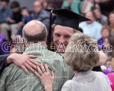 Jaden Nesbitt hugs his dad while smiling at his mom during the South Central Calhoun High School Class of 2017 Commencement Sunday afternoon. GRAPHIC-ADVOCATE PHOTO/ERIN SOMMERS