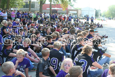 South Central Calhoun football players listen during the pep rally on the Lake City Square Friday, following the annual Homecoming Parade. GRAPHIC-ADVOCATE PHOTO/JERI VANDERHEIDEN