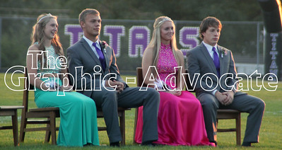 Jessica Hicks, Tanner Macke, Teylor Anderson and Tanner Fistler sit on the football field Wednesday night while the Homecoming Court is introduced. GRAPHIC-ADVOCATE PHOTO/ERIN SOMMERS