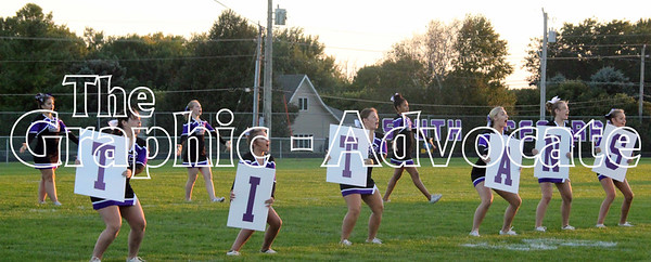 SCC Titans cheerleaders are seen on the field Wednesday night. GRAPHIC-ADVOCATE PHOTO/ERIN SOMMERS
