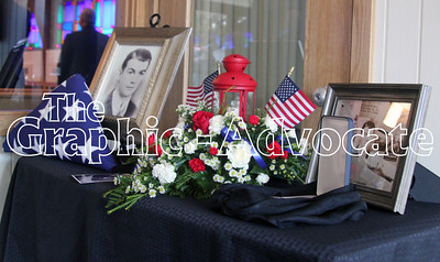 U.S. Navy Seaman Bernard Doyle, seen in the photos in this display, was killed in action during the attack on Pearl Harbor in 1941. His remains were identified earlier this year and brought to Lake City last week for burial near several of his siblings. GRAPHIC-ADVOCATE/ERIN SOMMERS