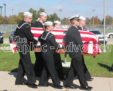 A Naval Honor Guard carries Seaman Bernard Doyle's casket out of St. Mary's Catholic Church in Lake City Saturday. GRAPHIC-ADVOCATE PHOTO/ERIN SOMMERS