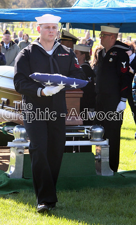A sailor brings the folded flag from Bernard Doyle's casket to an officer, to be presented to Doyle's sister, Fran Nutter. GRAPHIC-ADVOCATE PHOTO/ERIN SOMMERS