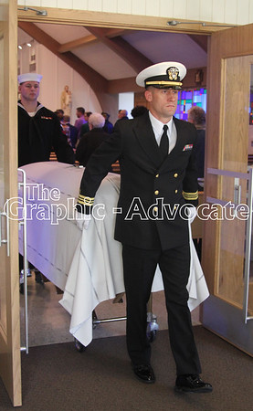 A Naval officer leads Seaman Bernard Doyle's casket out of St. Mary's Catholic Church Saturday. GRAPHIC-ADVOCATE PHOTO/ERIN SOMMERS
