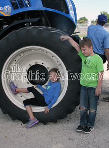 South Central Calhoun second-grade students check out a tractor Thursday morning during the Farm Safety Day at the Calhoun County Expo grounds. GRAPHIC-ADVOCATE PHOTO/ERIN SOMMERS