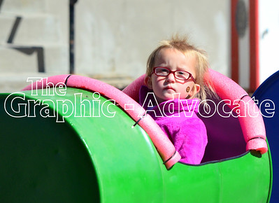 A young girl rides a train during Lake City's fall festival Sunday morning. GRAPHIC-ADVOCATE PHOTO/ERIN SOMMERS