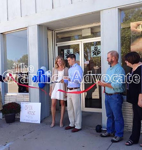 Dr. Jeff Redenius and his wife, Jen, cut a ribbon officially opening the chiropractic office and fitness center on Main Street in Lake City. The office hosted an open house Sunday during the chili cook-off and fall fest. PHOTO COURTESY JEFF REDENIUS