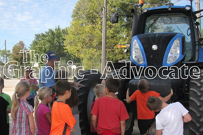Jerry Jacobs of Haley Equipment in Rockwell City speaks with South Central Calhoun Elementary School students about tractor safety. GRAPHIC-ADVOCATE PHOTO/ERIN SOMMERS