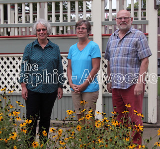 Karen Willis, left, Jane Johnson, center, and Lynn Dobson, right, have all helped to maintain the Lake City square flower gardens. Not pictured is Renee Stauter, who planted flowers in the gardens for several years. GRAPHIC-ADVOCATE PHOTO/ERIN SOMMERS