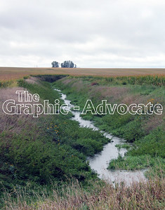 A drainage ditch is seen between Rockwell City and Lake City Friday morning. The Iowa Farm Bureau and the Iowa Corn Growers Association offered last week to fund the defense of 10 drainage districts in Calhoun, Buena Vista and Sac counties against a lawsuit. GRAPHIC-ADVOCATE PHOTO/ERIN SOMMERS