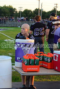 South Central Calhoun High School sophomore Jacy McAlexander fills water bottles for the SCC football team Friday night. GRAPHIC-ADVOCATE PHOTO/ERIN SOMMERS
