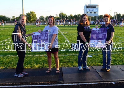 The Graphic-Advocate donated $250 each to the South Central Calhoun Athletic Boosters and the South Central Calhoun Fine Arts Boosters before Friday night's Homecoming football game in Lake City. The donation was part of the recently completed schedule poster project for each group. Editor Erin Sommers, left, presents a check and poster to Beth Stauter, vice president of the athletic boosters. At the far right, marketing representative Toni Venteicher presents a check and poster to Amy Westcott, president of the fine arts group.