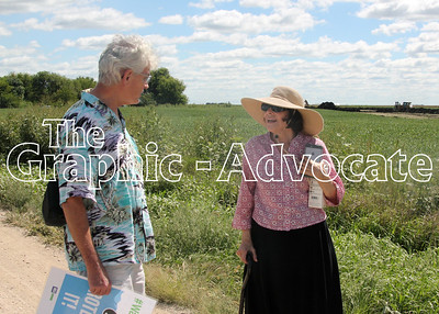 Cindy Koppola, right, speaks with a supporter Thursday afternoon on a road adjacent to her family's property south of Somers. Koppola protested the Dakota Access pipeline Thursday afternoon, but chose to stop the protest before being arrested. GRAPHIC-ADVOCATE PHOTO/ERINS SOMMERS