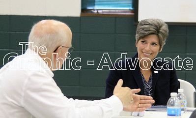 U.S. Sen. Joni Ernts, right, listens to Landus Cooperative CEO Milan Kucerak during a meeting in Farnhamville Aug. 31. GRAPHIC-ADVOCATE PHOTO/ERIN SOMMERS