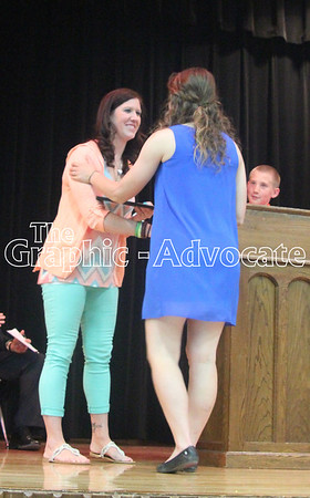Kylie Hildreth, left, shakes hands with Sarah Van Hulzen for winning the Nick Hildreth Memorial Scholarship. GRAPHIC-ADVOCATE PHOTO/ERIN SOMMERS