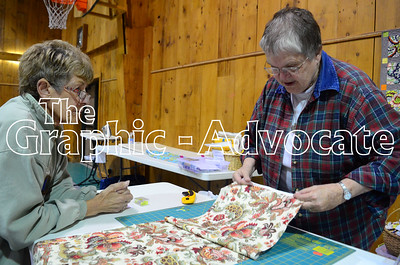 Marlene Armbrecht, right, helps a quilt retreat attendee align fabric Oct. 14 at Twin Lakes Christian Center. GRAPHIC-ADVOCATE PHOTO/ERIN SOMMERS