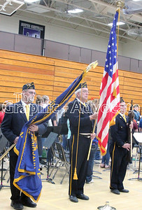 A color guard prepares to place flags at the Veterans Day program at SCC Middle School Friday. GRAHPIC-ADVOCATE PHOTO/ERIN SOMMERS