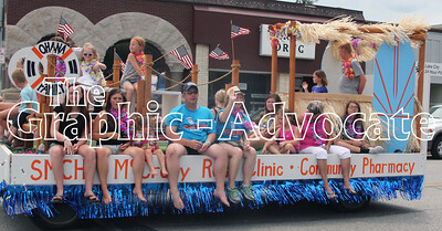 Stewart Memorial Community Hospital's Heather Cain waves to the crowd from the hospital's Western Days parade float Saturday. GRAPHIC-ADVOCATE PHOTO/ERIN SOMMERS