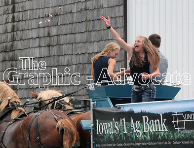 A girl enthusiastically throws candy from a parade entry Saturday in Lake City. GRAPHIC-ADVOCATE PHOTO/ERIN SOMMERS