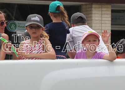 A child waves from the back of a truck during the 2016 Western Days parade. GRAPHIC-ADVOCATE PHOTO/ERIN SOMMERS